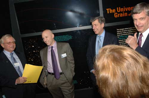 NASA Goddard Space Flight Center Director, Dr. Edward Weiler chats with NASA TV executive Producer Michael Starobin after a successful debut of NASA's Footprints movie at the Maryland Science Center on Dec. 7, 2006.