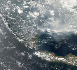 Thick smoke from wildfires spreads across Sumatra and Indonesia on Nov. 5, 2006, as seen from the Aqua satellite.