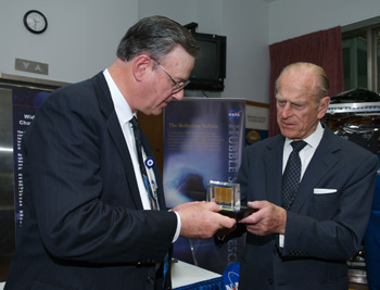 Hubble Spece Telescope Program Manager presents Prince Philip with three solar cells.