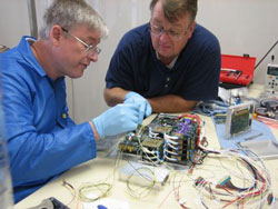 Dr Billy R Smith and Charles Morgan assemble the avionics module for MidSTAR-1.