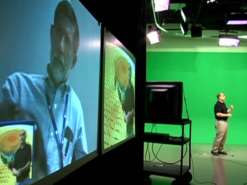Image of Dr. Halverson standing in front of the green screen