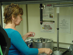 Image of a researcher setting up the low-cost process for manufacturing carbon nanotubes