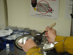 Image of the innovative CNT manufacturing process that uses helium arc welding to vaporize a carbon rod