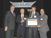 OMNI team members accept an award from an NAA representative.