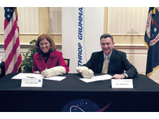 Laurie Leshin, NASA Goddard Deputy Director of Science & Technology and Joseph J. Ensor, vice president/general manager of Northrop Grumman's Space and ISR Systems Div. sign the agreement.