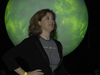 Laurie Leshin in front of Goddard's Science on a Sphere exhibit