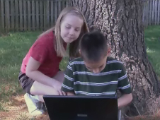 Two children with laptop