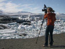 Maria Frostic films the iceberg lagoon.