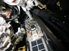 Astronaut Andrew Feustel practices installing the Fastener Capture Plate