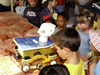 Children look at a rover