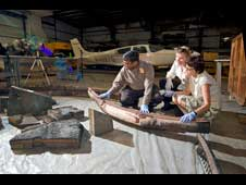 Ethiraj Venkatapathy, NASA Ames; Betsy Pugel, NASA Goddard and Hanna Szczepanowska National Air and Space Museum Conservator, examine the 1966 Apollo test vehicle heat shield.