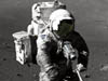 Harrison Schmitt, Apollo 17 lunar module pilot, using an adjustable sampling scoop to retrieve lunar samples
