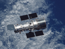 Hubble floats above the Earth following its release on Servicing Mission 3B.