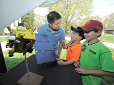 children examine an LRO model