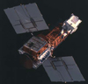 The Solar Maximum Mission (SMM) satellite as photographed by an astronaut during the 1984 Space Shuttle mission to repair the ailing satellite.