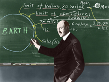 Colorized black-and-white photo of Dr. Robert Goddard at a chalkboard.