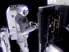 Astronaut working on Hubble equipment while in space.