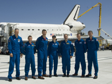 The crew of space shuttle mission STS-125 gathered on the runway after the shuttle Atlantis landed.