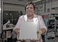 Wanda Peters holds material with lotus coating