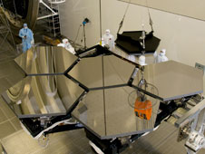 Six of the 18 James Webb Space Telescope mirror segments are being prepped to move into the X-ray and Cryogenic Facility, or XRCF, for testing.