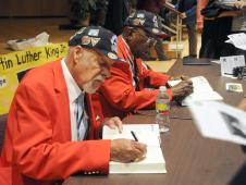 Tuskegee Airmen sign autographs