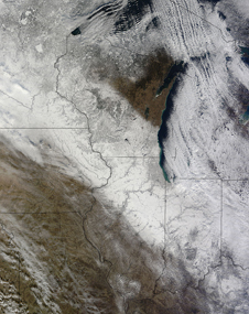 MODIS image of snow blanketing the upper Midwest including lake effect clouds blowing off Lake Michigan