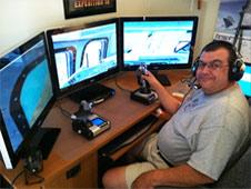 Bob Freitas running his flight simulator.