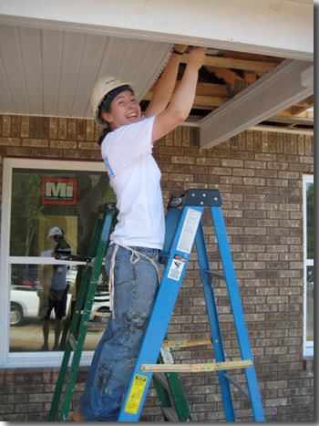 Christine Redmond working for Habitat for Humanity