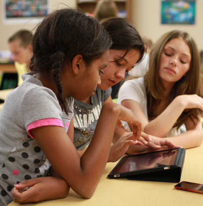 Girls looking at NASA Viz iPad app