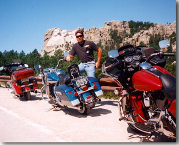 Pictured here is John at Mount Rushmore, South Dakota, during a summer 2000 road trip he took with some friends.