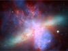 composite image of galaxy M82 created with Hubble, Chandra and Spitzer telescope data