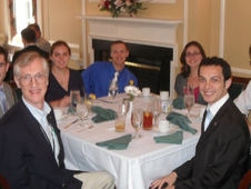 Goddard's John Mather sits with international students at an awards dinner