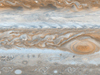 Cassini mosaic image of Jupiter showing gravity anomaly affecting its jet stream near the red spot.