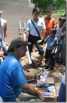 Bob Savage distributing school supplies to poor children on a mission trip to Camalote, Honduras in 2007.