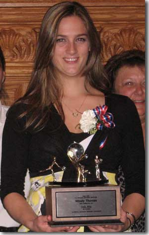 Mindy Thomas with her duckpin bowling trophy.