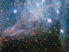 stars peer through a blue/lavender haze in NGC 2040