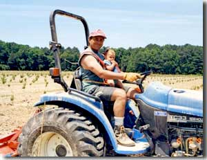 Mark and Greer on the tractor circa 1999.