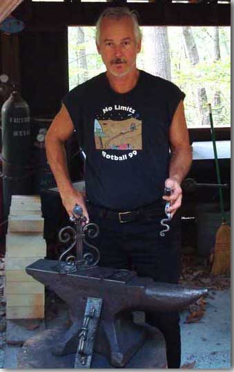Dave Martin at work at his anvil