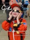 child observes Venus transit 2012