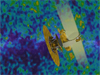 Conceptual image of WMAP superimposed over image of cosmic microwave background radiation