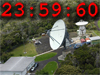 image of satellite dish superimposed with 23:59:60 text