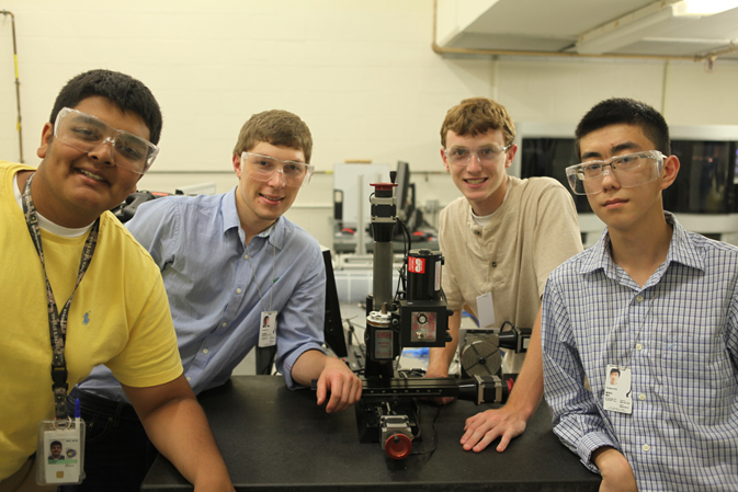 Parth Aghera, Daniel Diazcastillo, Kirby Carmack, and Ming Ma stand around the Sherline mill