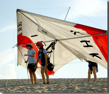 Joie taking her first hang gliding lesson at Kitty Hawk, North Carolina