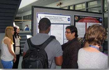 Photo of Raul Garcia at his poster session.