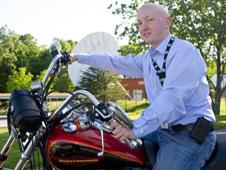 Chris Tinker on his Harley
