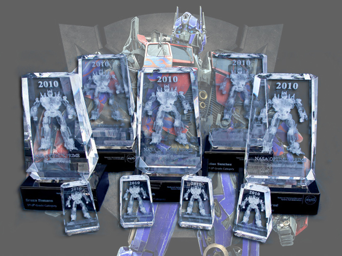 Background: OPTIMUS PRIME, Foreground: 2010 NASA OPTIMUS PRIME Spinoff Video Contest awards.