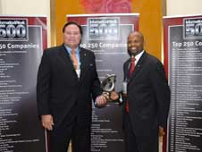 Mecum and Gardner accepting the InformationWeek Technology award.