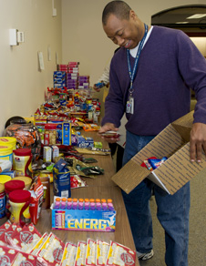 Goddard employee packs gifts for service members