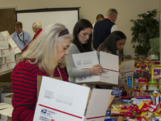Goddard employees packs gifts for service members