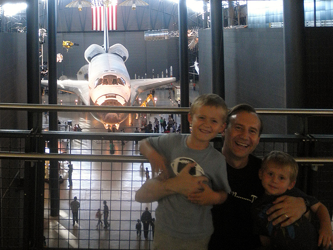 Paulo Oemig at the National Air and Space Museum Steven F. Udvar-Hazy Center in Oct. 2012 with his two sons, Ronan to his right, and Liam. The Discovery Shuttle is in the background.